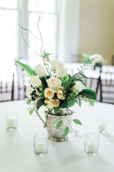 Ivory floral arrangement for light soft table setting