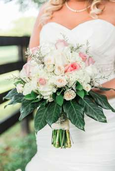 Traditional tight bridal bouquet in ivory and pink