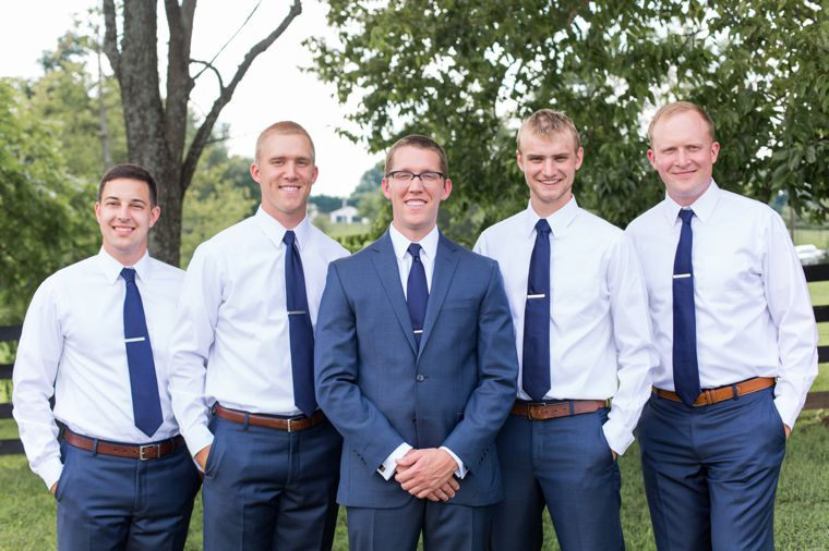 Dapper, southern, traditional groom and groomsmen in navy, brown and white