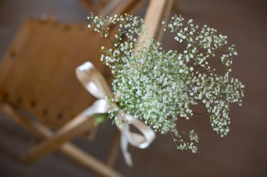 Aisle flowers- baby's breath and ribbon