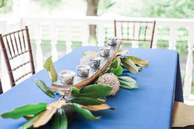 Bourbon barrel candle holder centerpiece on banquet table. Emily Wakin Photography.