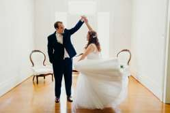 Bride & Groom in historic mansion with traditional romantic vibes