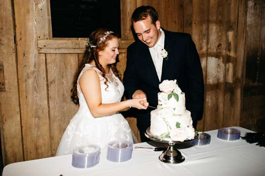 Cake cutting at traditional romantic wedding reception