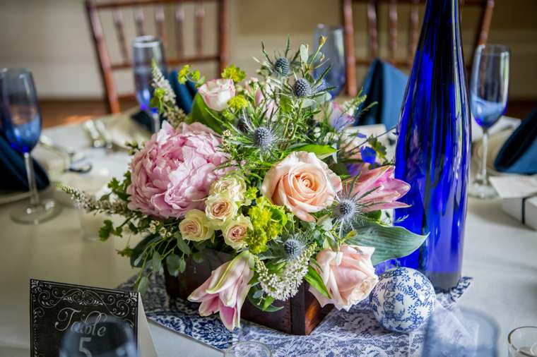 Pink and blue floral centerpiece in wooden box