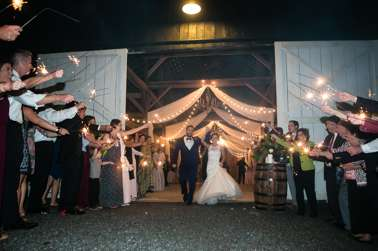 Sparkler send off from classy rustic southern glam barn wedding reception
