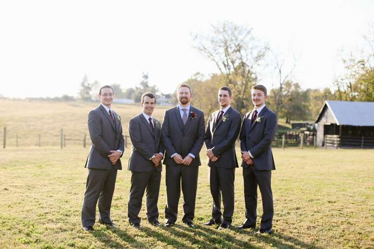 Groomsmen in grey blue suits for rustic elegant Kentucky fall wedding
