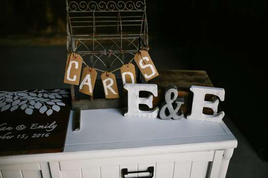 Welcome table for guestbook, gifts and cards at rustic elegant fall wedding
