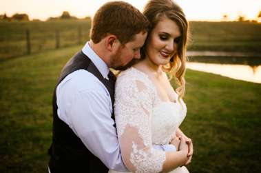 Sunset pictures of bride & groom at rustic elegant fall wedding
