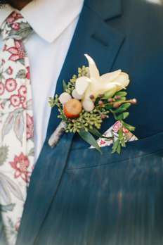 Groom's Attire | Boutonniere with acorn on navy suit, floral tie and pocket square