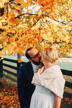 Fall wedding on Kentucky farm with golden leaves