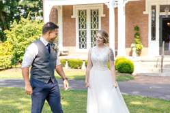 First look between bride and groom at romantic raspberry wedding