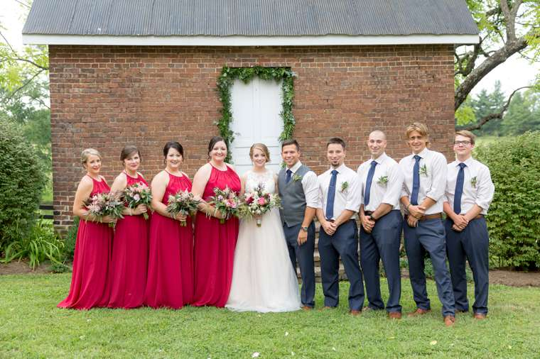 Wedding party in red and navy at romantic summer wedding