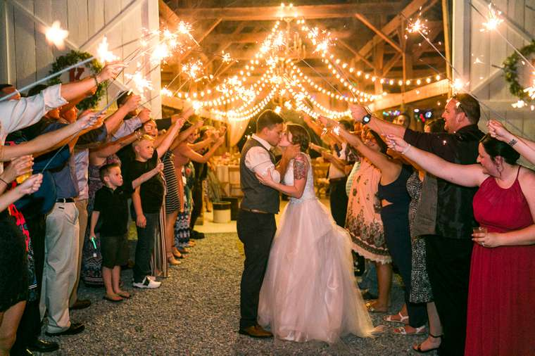 Sparkler sendoff during romantic red respberry and navy summer wedding
