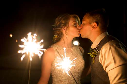 Couple with sparklers for reception exit