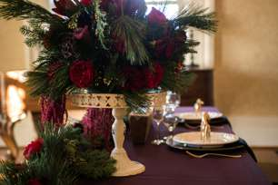 Kentucky inspired table setting with winter greenery and purple, ruby red and burgundy florals