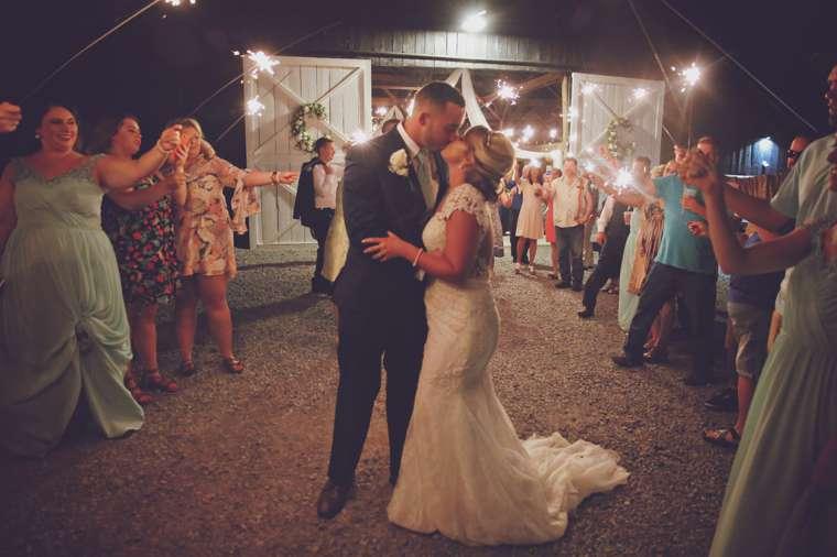 Sparkler send off from vintage glam barn wedding reception