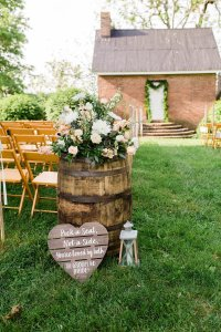 Bourbon Barrel Flower Arrangements at Outdoor wedding ceremony