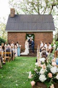 Exchange rings during Warrenwood Manor outdoor wedding ceremony