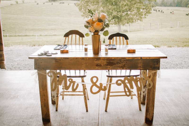 Farmhouse table for sweetheart table at country glam wedding