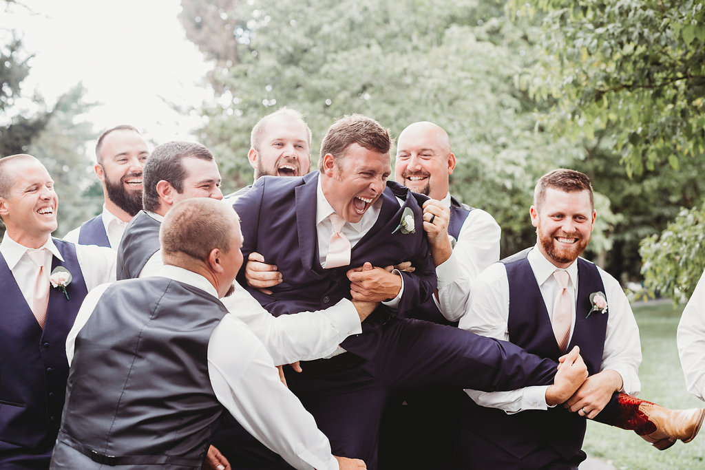 Groomsmen having fun at Country Glam Wedding at Warrenwood Manor