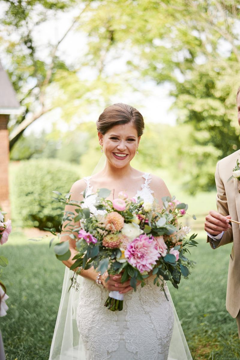 Southern glam bride with locally grown floral bouquet