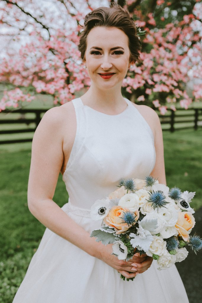 Bride with peach and blue bouquet at Vintage Spring Wedding - Warrenwood Manor -Kentucky Wedding Venue
