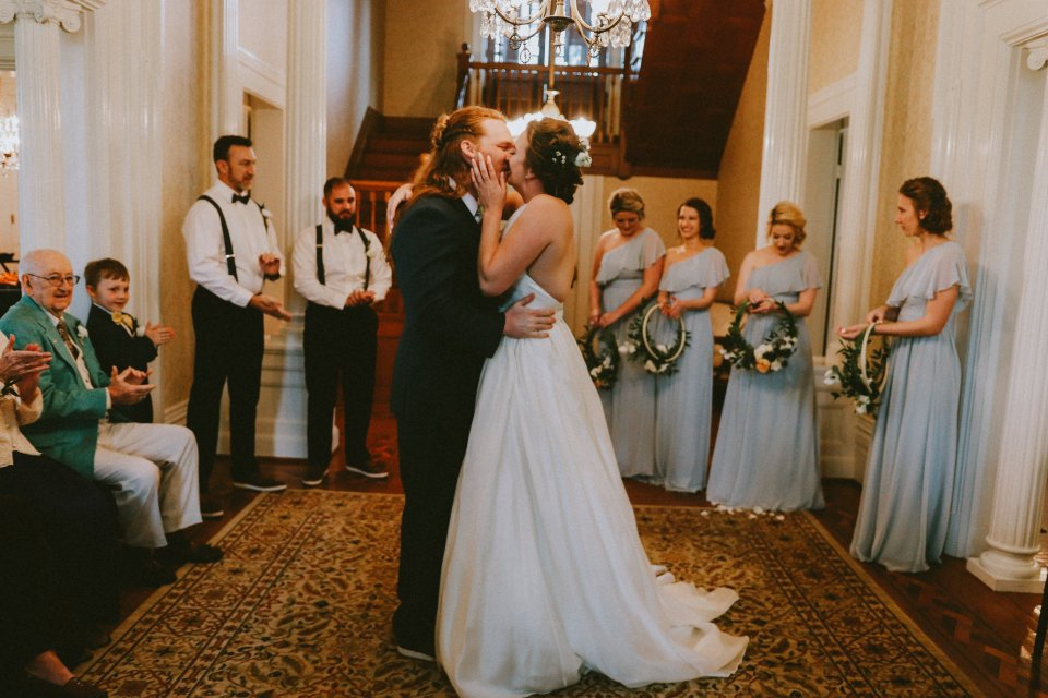 First kiss during ceremony in Historic House at Vintage Spring Wedding - Warrenwood Manor -Kentucky Wedding Venue