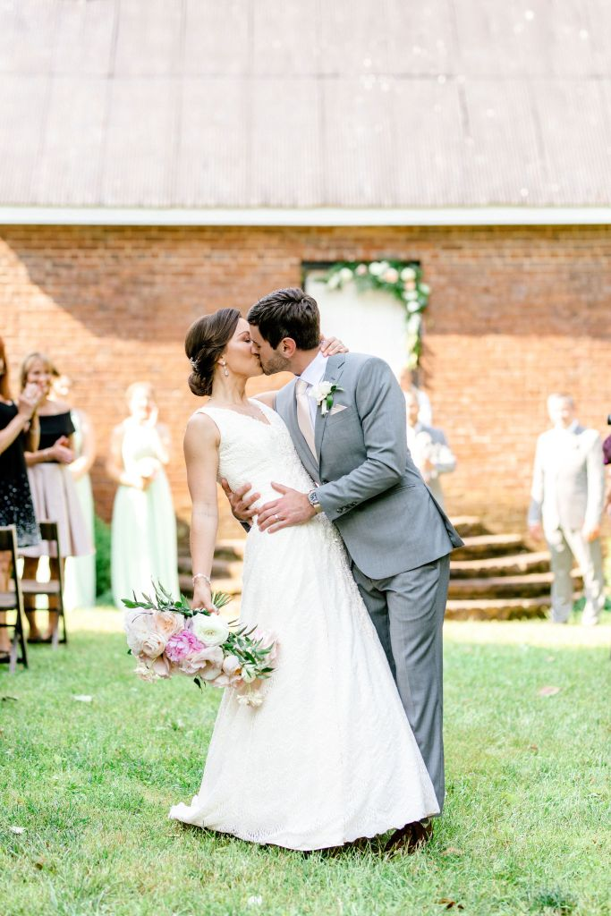 Pastel Spring Southern Chic Wedding at Warrenwood Manor - Kentucky Wedding Venue- Couple kiss as they exit their wedding ceremony