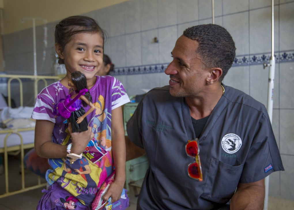 Branden Collinsworth and a Peruvian girl at the hospital
