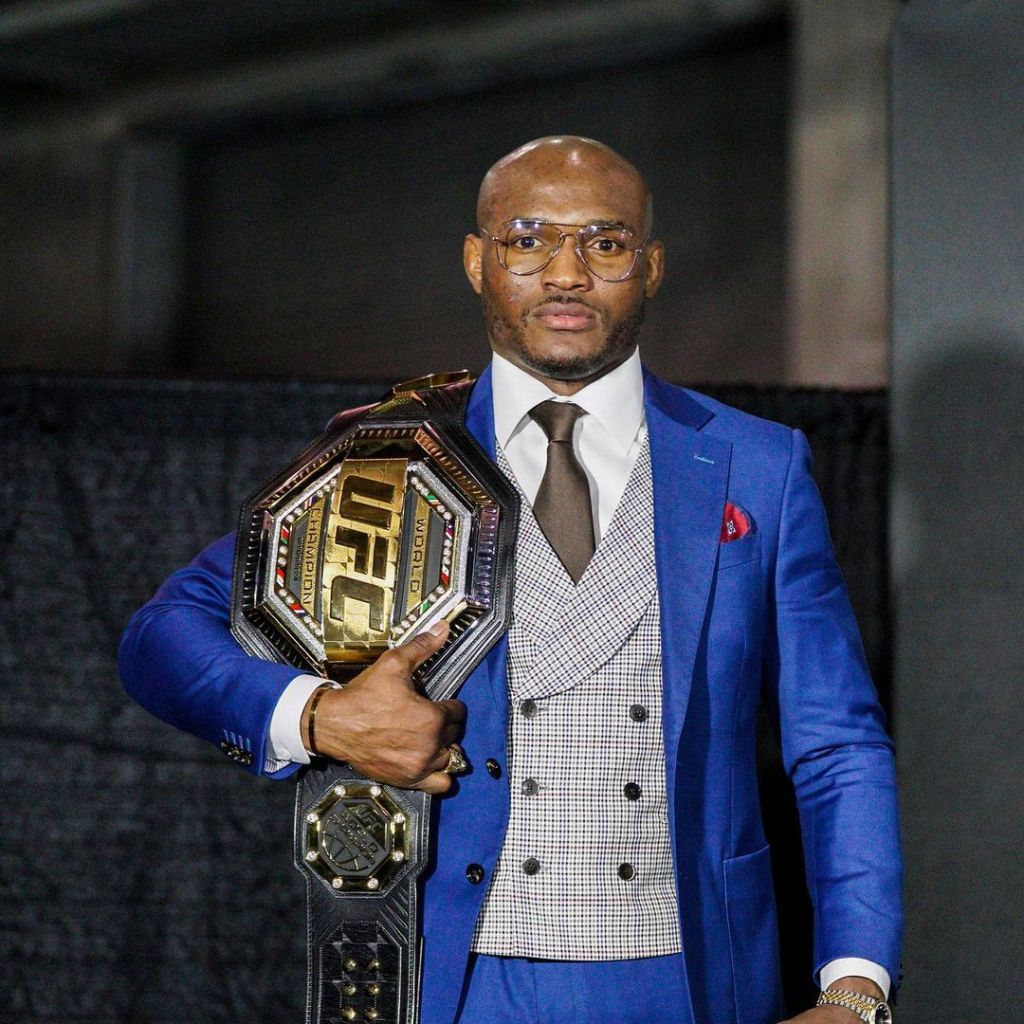 Adorable photo of UFC champion, Kamaru Usman and his daughter posing with his belt