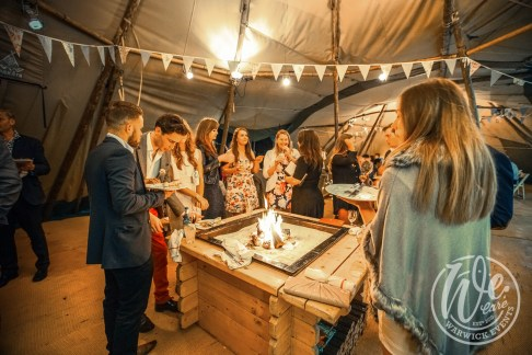 Guests Around Firepit in Tipi