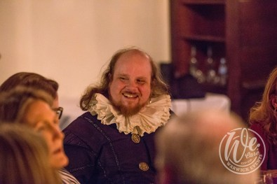 William-Shakespeare-actor-at-dinner-laughing-with-guests