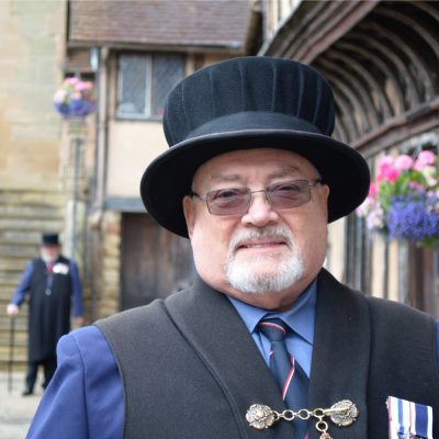 man in waistcoat and top hat at the Lord Leycester Hospital