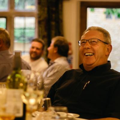 Man laughing, enjoying a whisky tasting