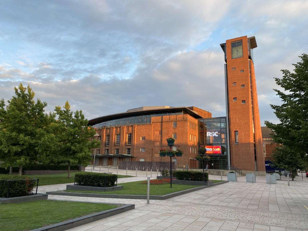 RSC theatre and tower lit by sunset