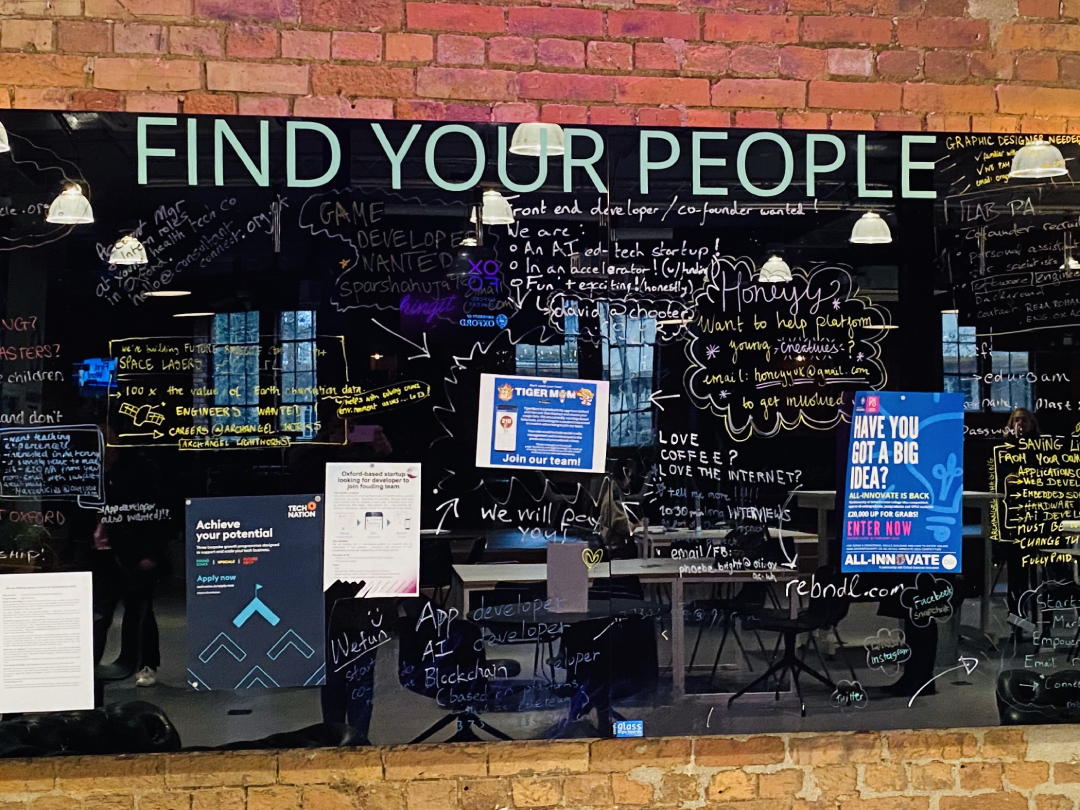 """Find your people"" written on shiny surface"