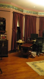 hard wood floors, windows with drapes, desk, computer