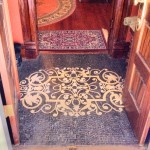 blace and white tile flooring between to sets of doors leading to entrance hall