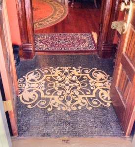 blace and white tile flooring between two sets of doors leading to entrance hall