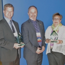 2013 WA-ACEP Guardian of Emergency Medicine Award winners Tim Layton, JD (left) and Susie Tracy (right) pictured with Dr. Stephen Anderson, WA-ACEP Past President.
