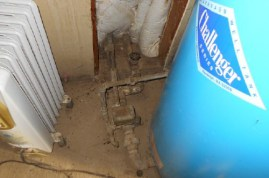 Pressure Tank and pipes in insulated well house
