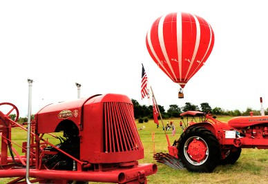 Antique tractors and farm machinery lined entry way the Fort Atkinson stockade. In the background Rich Jaworski Heritage Days offered guests an aerial view of Fort Atkinson Saturday morning from his tethered hot air balloon.