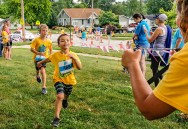 Nolan Olson dashes toward the finish Blair Kids Tri