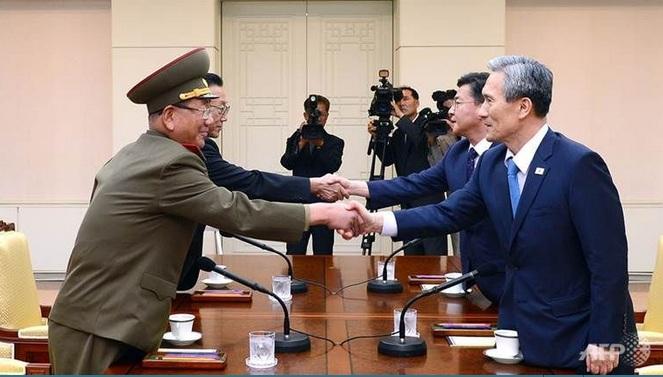 North, South Korea agree to defuse crisis after marathon talks