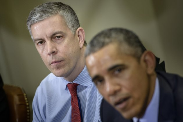 US Secretary of Education Arne Duncan (L) listens while US President Barack Obama makes a statement to the press after a meeting with the Council of the Great City Schools Leadership in the Roosevelt Room of the White House March 16, 2015 in Washington, DC. Obama spoke about the education budget. AFP PHOTO/BRENDAN SMIALOWSKI (Photo credit should read BRENDAN SMIALOWSKI/AFP/Getty Images)