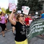Hundreds protest DeVos in Colorado