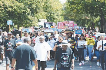 National Action Network teamed with several civil rights organizations and gun safety and labor groups at Folger Park in southeast D.C. to march to the National Rifle Association headquarters for a rally calling for stricter gun control on Aug. 27. Photo by Roy Lewis