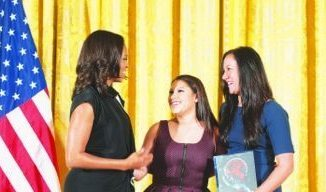 CityDance DREAM program director Kelli Quinn and student representative Valeria Cruz accept the 2015 National Arts and Humanities Youth Program Award from first lady Michelle Obama on behalf of the multifaceted after-school dance program at the White House on Nov. 17. (Steven E. Purcell)