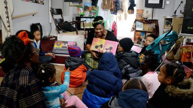 Children's books author Sherrita Berry-Petus reads to children attending the Magical-Mirrors book fair at Sankofa Video Books & Cafe in Northwest on Sunday, Dec. 11.