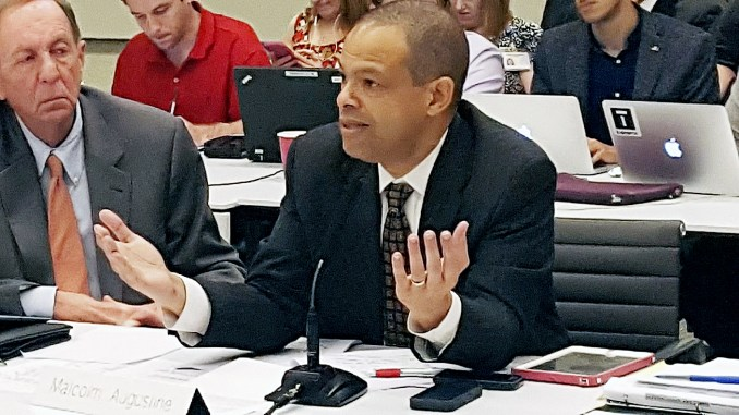 Metro board member Malcolm Augustine, who represents Prince George's County, pleads his case regarding the late-night service proposal during a Dec. 1 committee meeting at the transit agency's headquarters in Northwest. /Photo by William J. Ford